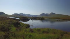 Stunning drone shot in Scotland of Lochan na h-Achlaise by Rannoch Moor Stock Footage