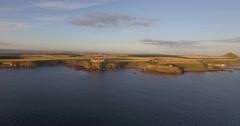 Aerial shot off the coast heading towards Tantallon Castle Stock Footage
