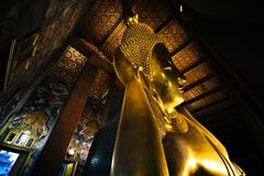 The Reclining Buddha at Wat Pho, in Bangkok, Thailand. - stock photo