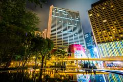 Stock Photo of Skyscrapers and a fountain at Victoria Park at night, in Causeway Bay, Hong K
