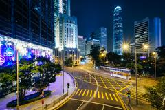 Long exposure of an intersection and modern skyscrapers at night, at Central, - stock photo