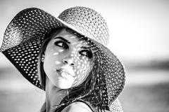 Sweet girl in a hat. Black and white photo. Stock Photos