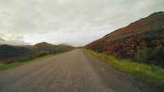 Scotland driving hillside road Stock Footage