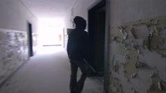 Stock Video Footage of Vandal with mask in abandon building