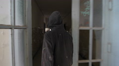 Vandal with mask in abandon building - stock footage