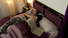Man angry with annoying girlfriend in bed - stock footage
