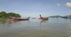 Tracking shot of a long tail boat in Thailand near Patong Stock Footage