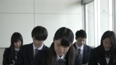 Japanese high-school students studying in the classroom Stock Footage