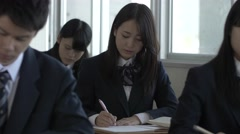 Japanese high-school students studying in the classroom - stock footage