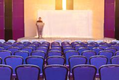 Speaker prepares to lecture but people not interested in listening to lecture Stock Photos