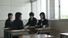Japanese high-school students talking in the classroom Stock Footage
