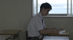 Japanese high-school student studying in the classroom Stock Footage