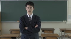 Japanese high-school student in front of the chalkboard - stock footage