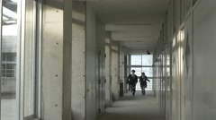 Japanese high-school students running in the corridor outside the classroom Stock Footage