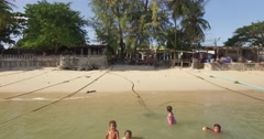 Aerial/Drone shot of a fishing village in Thailand. Stock Footage
