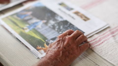 Close up of hands of Caucasian man reading newspaper Stock Footage