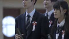 Japanese high-school students in uniform during graduation ceremony Stock Footage