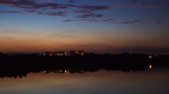 4k timelapse of city skyline reflected in lake, Olsztyn city in Poland. Stock Footage