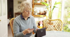 Senior woman using a digital tablet to shop online. Shot on RED Epic. Stock Footage