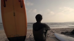 Japanese surfer looking at the sea from the beach, Chiba Prefecture, Japan Stock Footage