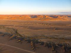 Stock Photo of Dawn Kulala Wilderness Reserve Namib Desert Tsaris Mountains Tsauchab ephemeral