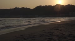 Waves crashing on the beach at sunset, Chiba Prefecture, Japan Stock Footage