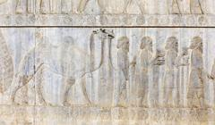 Ancient relief of the Achaemenids delegation of the Parthians with camel Stock Photos