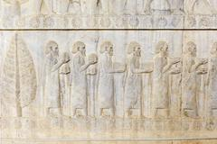 Ancient relief of the Achaemenids delegation of the Ionians Apadana Palace Stock Photos