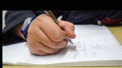 Student doing his mathematics homework in a study room. - stock footage