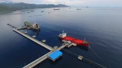 Aerial view. Oil tanker at the pier. Indonesia, Bali Stock Footage
