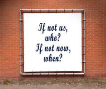 Large banner with inspirational quote on a brick wall Stock Photos