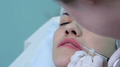 Lip injection plastic surgery. Closeup upper lip - stock footage