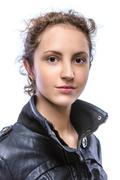Curly young woman in black jacket Stock Photos