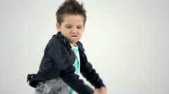 Kid dances as a rock star in slow motion Stock Footage