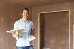 Plaster Working In Finished Room - stock photo