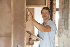 Plasterer Working On Wall - stock photo