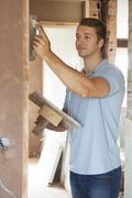 Plasterer Working On Wall Stock Photos