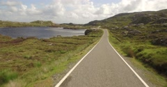 Lovely aerial shot along the east coast of the Isle of Harris, Scotland Stock Footage