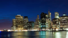 Time lapse sunset shot of lower Manhattan and Brooklyn bridge, New York, USA Stock Footage