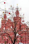 MOSCOW, RUSSIA - NOVEMBER 26: Bare tree decorated with Christmas balls on Red - stock photo
