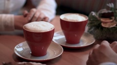 Two people in cafe take the cups from the table Stock Footage