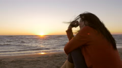 Sad woman in front of sunset dolly shot 4K - stock footage