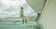 Philippines - Girl sitting on pontoon over turquoise water Stock Footage