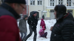 TALLIN, ESTONIA - Children play on a snow pile during heavy snowfall Stock Footage