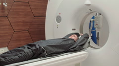 Young male in MRI machine Stock Footage