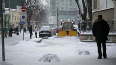 TALLIN, ESTONIA - Snow removal equipment working on streets of Stock Footage