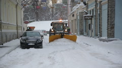 TALLIN, ESTONIA - Snow removal equipment working on streets of - stock footage