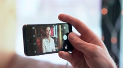 A man taking photo on cellphone Stock Footage