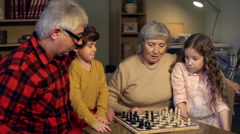 Teaching to Play Chess Stock Footage