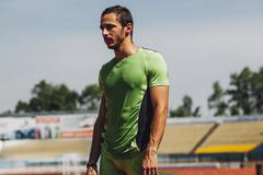 Young male athlete sweating in stadium Stock Photos